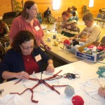 DeAnna Amos teaching her Wagon Wheel Weaving class.